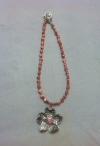 Flower pendant with pearl, coral-colored beads and silver accents